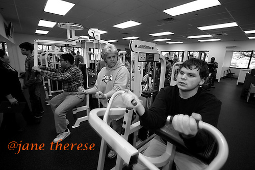 Spike Lofgren 17 who is autistic, gets some motivational encouragement by Joanne Monaco on Thursday February 9, 2006, who cordinates the family support workshops for the Eden Institute in Princeton, NJ. She is also the Area Director for the Mercer County Special Olympics in Lawrence Twp., NJ. This is the only workout facility, by the Special Olympics in the nation that the developmentally disabled have to work out. Spike and hius classmates from the Eden Institute work out and compete yearly in the Special Olympics. Spike has had therapy at an early age due to a large part in his mother's devotion to get Spike the proper care that was needed. Early intervention is so important in autism resulting in correct synaptic impulses in the brain and may contribute to the lessen of severity of autism. photo by jane therese.