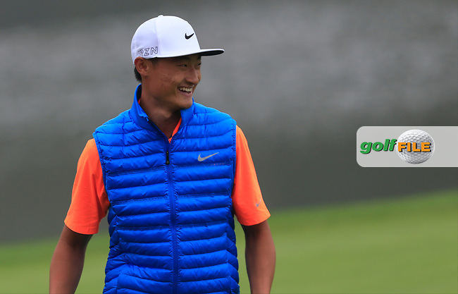 Li Haotong (CHN) on the 18th green during Round 4 of the WGC HSBC Champions at the Sheshan International Golf Club in Sheshan, Shanghai, China on Sunday 13/09/15.<br /> Picture: Thos Caffrey | Golffile