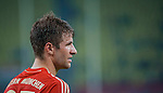 Thomas Muller of Bayern Munich in action during a friendly match against VfL Wolfsburg as part of the Audi Football Summit 2012 on July 26, 2012 at the Guangdong Olympic Sports Center in Guangzhou, China. Photo by Victor Fraile / The Power of Sport Images