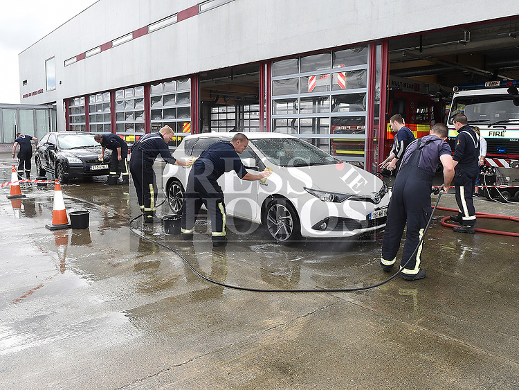 Firemen at Drogheda Fire Station who held a car wash to raise funds for Hannah Donnelly. Photo:Colin Bell/pressphotos.ie