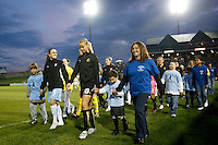 Heather O'Reilly (9) of Sky Blue FC and Leslie Osborne (10) of FC Gold Pride lead their teams onto the field before the start of the game. Sky Blue FC and FC Gold Pride played to a 1-1 tie during a Women's Professional Soccer match at TD Bank Ballpark in Bridgewater, NJ, on April 11, 2009. Photo by Howard C. Smith/isiphotos.com