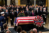 Members of the Supreme Court pause infront of the flag-draped casket of former President George H.W. Bush lying in state at the U.S. Capitol Rotunda in Washington, Monday, 3, 2018. From l-r., are Chief Justice John Roberts, Associate Justice Clarence Thomas, Associate Justice Stephen Breyer, Associate Justice Sonia Sotomayor, Associate Justice Samuel Alito, Associate Justice Elena Kagan, Associate Justice Neil Gorsuch, and Associate Justice Brett Kavanaugh. (AP Photo/Pablo Martinez Monsivais/Pool)