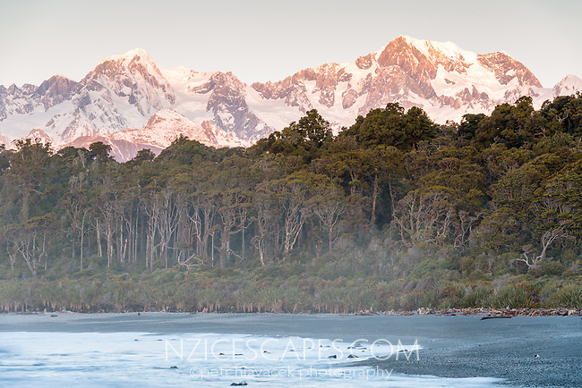 Sunset at Gillespies Beach with winter views of Mt. Tasman (left) 3497m and Aoraki Mt. Cook (right) 3724m, two highest New Zealand mountains, Westland Tai Poutini National Park, West Coast, UNESCO World Heritage Area, New Zealand, NZ