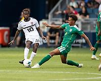 KANSAS CITY, KS - JUNE 26: Kevin Molino #10 advances the ball against Elliot Bonds #4 during a game between Guyana and Trinidad