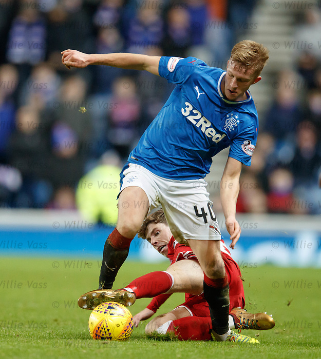 Ryan Christie fouls Ross McCrorie for his second yellow and sees red