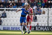 Ben Nugent of Stevenage beats Luke Norris of Colchester United to the ball during Colchester United vs Stevenage, Sky Bet EFL League 2 Football at the JobServe Community Stadium on 5th October 2019