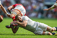 Joe Launchbury of England puts in a tackle. Old Mutual Wealth Cup International match between England and Wales on May 29, 2016 at Twickenham Stadium in London, England. Photo by: Patrick Khachfe / Onside Images