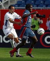 San Jose's Ramiro Corrales, left, New England's Shairie Joseph, right, San Jose vs. New England, Foxboro, Ma, May 3, 2003. San Jose won 2-0.