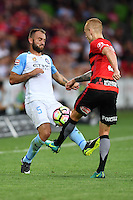 Melbourne, 6 January 2017 - IVAN FRANJIC (5) of Melbourne City and JACK CLISBY (3) of the Wanderers fight for the ball in the round 14 match of the A-League between Melbourne City and Western Sydney Wanderers at AAMI Park, Melbourne, Australia. Melbourne won 1-0 (Photo Sydney Low / sydlow.com)