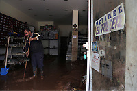 Pictured: A shop owner cleans his store.<br /> Re: People have died, some still missing and severe damage caused by heavy rain and flash flooding in the area of Mandra, near Athens, Greece. Thursday 16 November 2017