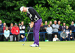 Peter Hanson (SWE) takes his putt on the 1st green during the Final Day of the BMW PGA Championship Championship at, Wentworth Club, Surrey, England, 29th May 2011. (Photo Eoin Clarke/Golffile 2011)