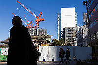 A skyscraper under construction behind a shrine near Omotesando, Tokyo, Japan. Saturday January 5th 2019