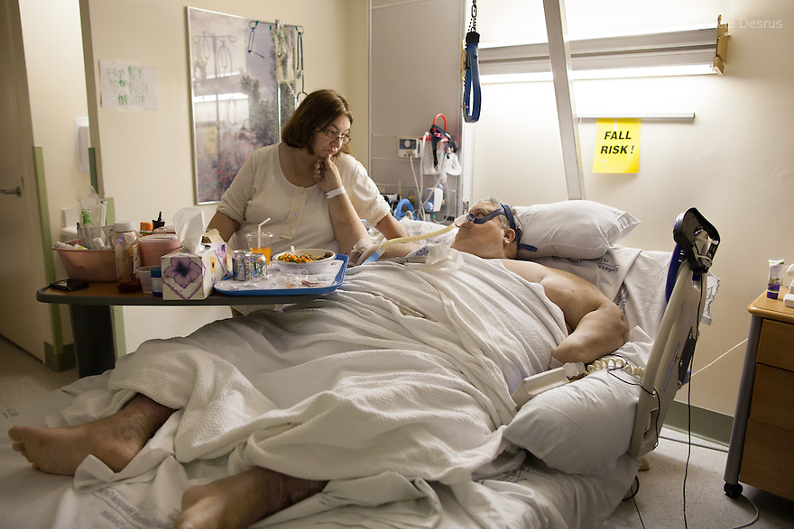 Michael Hebranko, and his wife Madelaine Hebranko, at the St. Luke's-Roosevelt Hospital in New York on November 9, 2012. <br /> Michael Hebranko is an American man suffering from an extreme case of morbid obesity, known to be among the heaviest people in the world. Michael was born in Brooklyn in 1954. At the age of 16 his weight was 353 pounds. In 1990, he was recorded in the Guinness Book of World Records for the highest recorded weight loss. He dropped his weight from 906&nbsp;pounds to 200&nbsp;pounds in 19 months with the help of the dieting and exercise coach Richard Simmons. But then he gained most of the weight back again and in June 1999, Hebranko was at his peak weight of 1,100 pounds. Over the past years, he had to be repeatedly hospitalized and today he weighs 550 pounds and is battling for his life. He says: &ldquo;I'm a food addict, and like any alcoholic who has their first drink, or heroin addict who first injects, I fell off the wagon.&rdquo; <br /> Michael Hebranko died on July 25, 2013. He was an advocate for the obese and founded OPIN, a non-profit organization dedicated to teaching and helping people that suffered from obesity and also educating the public on this condition. His whole life he battled with obesity. Photo by B&eacute;n&eacute;dicte Desrus