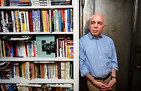 "Author Michael Wolffwho's latest book ""Fire and Fury: Inside the Trump White House,"" has sparked a war of words between the President and former advisor Steve Bannon, is pictured in his Manhattan apartment in 2008. photo by Trevor Collens"