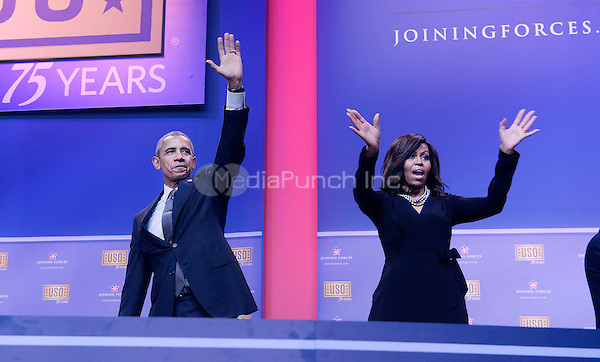 United States President Barack Obama and First Lady Michelle Obama wave at the kick off of the 5th anniversary of Joining Forces and the 75th anniversary of the USO at Joint Base Andrews on May 5, 2016 in Maryland. <br /> Credit: Olivier Douliery / Pool via CNP/MediaPunch