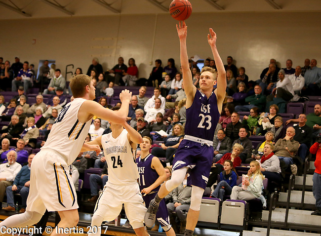 SIOUX FALLS, SD - DECEMBER 31: Drew Guebert #23 from the University of Sioux Falls shoots over a pair of defenders including Marcus Asmus #30 from Augustana University during their game Sunday afternoon December 31, 2017 at the Stewart Center in Sioux Falls, SD.  (Photo by Dave Eggen/Inertia)