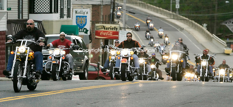 THOMASTON, CT, 6 May 2006- 050606BZ07- Motorcyclists ride into Thomaston Saturday in memory of Noah Rogozinski, the 5-year-old son of a police sergeant who died last year.  The ride raised money for a playground to be built at Black Rock School in memory of Rogozinski.<br />  Jamison C. Bazinet Republican-American