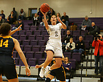 SIOUX FALLS, SD - DECEMBER 7: Anna Goodhope #2 from the University of Sioux Falls takes the ball to the basket past Concordia St. Paul during their game Friday night at the Stewart Center in Sioux Falls, SD. (Photo by Dave Eggen/Inertia)
