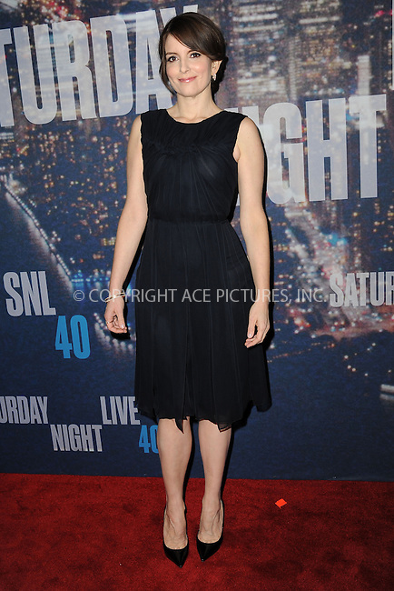 WWW.ACEPIXS.COM<br /> February 15, 2015 New York City<br /> <br /> Tina Fey walking the red carpet at the SNL 40th Anniversary Special at 30 Rockefeller Plaza on February 15, 2015 in New York City.<br /> <br /> Please byline: Kristin Callahan/AcePictures<br /> <br /> ACEPIXS.COM<br /> <br /> Tel: (646) 769 0430<br /> e-mail: info@acepixs.com<br /> web: http://www.acepixs.com
