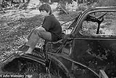 Playing on the old car, Summerhill school, Leiston, Suffolk, UK. 1968.