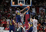 Caja Laboral Baskonia's Fernando San Emeterio (r) make the winner basket against FC Barcelona's Terence Morris during ACB Finals match. June 15,2010. (ALTERPHOTOS/Acero)