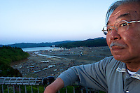 Takeo Sasaki,63, close too new temporary housing that comes with flat screen TV,  air conditioner, microwave, oven, fitted bathroom in Minamisanriku, Myiagi, Japan. The fishing port of Minamisanriku, Miyagi, Japan was devastated by the tsunami where the popultion was reduced from 18,000 to about 8,000
