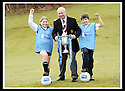 24/02/2009  Copyright Pic: James Stewart.File Name : sct_jspa06_scottis_cup.FORMER FALKIRK LEGEND ALEX TOTTEN SHOWS OFF THE HOMECOMING SCOTLAND SCOTTISH CUP TO SARAH JOHNSTON AND IAN MCARTHUR, PRIMARY SEVEN PUPILS AT ST MARGARET'S PRIMARY SCHOOL, POLMONT......Press Release..... A unique interactive tour to engage primary school children with football and the Homecoming Scottish Cup rolls into town today, Tuesday 24 February 2009 at St Margaret's Primary School in Falkirk.  . .Up to 100 pupils in primaries 5 to 7 at each local school will receive specialist skills and drill training from Scottish Football Association coaches as well as getting the chance to view the Homecoming Scottish Cup trophy itself.. .The school tour takes the form of a giant 'football-shaped' tent, which houses the world's oldest footballing trophy and information about Homecoming Scotland and the Scottish Cup tournament.. .Future football stars will be given soccer skills training ahead of watching their home team, Falkirk, take on Inverness Caledonian Thistle in the quarter finals of the Homecoming Scottish Cup on the weekend of 7 March.. .Falkirk legend Alex Totten, who used to manage the side, will be on hand at St Margaret's Primary School to share his knowledge and experience with the kids and to see the trophy himself.. .All primary schools in Scotland will also be sent education packs to encourage pupils to know more about Homecoming Scotland and to learn more about healthy eating, fitness and playing football as a way to keep fit and have fun.  . .As part of the football celebrations, the tour will then encourage locals in the town centre to get behind their local team, when the cup visits The Mall in Falkirk later in the afternoon.. .The Homecoming Scottish Cup Tour has been designed to engage with Scotland's local communities and spread the message about joining in the celebrations for Homecoming Scotland 2009, a programme comprising over 300 events to celebrate Scotland's culture, h