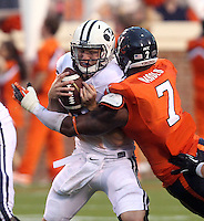 Brigham Young quarterback Taysom Hill (4) is sacked by Virginia defensive end Eli Harold (7) during the first half of the game in Charlottesville, Va. Virginia defeated Brigham Young 19-16. Photo/Andrew Shurtleff