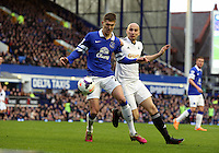 Pictured L-R: John STones of Everton is challenged by Jonjo Shelvey of Swansea.  Saturday 22 March 2014<br />