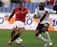 Calcio, Serie A: Roma vs Bologna. Roma, stadio Olimpico, 1 novembre 2009..Football, Italian serie A: Roma vs Bologna. Rome, Olympic stadium, 1 november 2009. AS Roma forward Julio Baptista, of Brazil, left, kicks the ball as Bologna midfielder Gaby Mudingayi, of Belgium, tries to stop him..UPDATE IMAGES PRESS/Riccardo De Luca