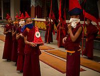 Buddhist monk preparing for a Losar procession in Sikkim, India
