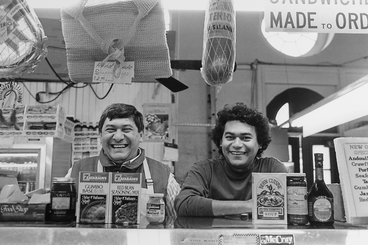 Joe and Jorge shopkeeper at deli stand in Eastern Market with displays of future grocery dry product, on Oct. 22, 1993. (Photo by Laura Patterson/CQ Roll Call via Getty Images)