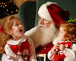 Elizabeth,3, and Jane Slocum,2, tell Santa(Ed Niederhofer) what they want for Christmas at Memorial City Mall Wednesday Dec. 6,2006.(Dave Rossman/For the Chronicle)<br />