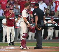 NWA Democrat-Gazette/J.T. WAMPLER Arkansas' head coach Dave Van Horn argues a call that allowed two South Carolina runs Monday June 11, 2018 during the NCAA Super Regional at Baum Stadium in Fayetteville.