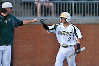 Center fielder Reece Hampton (2) of the Charlotte 49ers celebrates scoring a run in the third inning of Game 2 of a doubleheader against the Fairfield Stags on Saturday, March 12, 2016, at Hayes Stadium in Charlotte, North Carolina. (Tom Priddy/Four Seam Images)