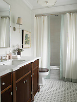 This custom bathroom features a handmade Savannah floor shown in Carrara, Thassos, and Bardiglio from New Ravenna.<br />