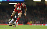 Wales centre Jamie Roberts leaves Fiji prop Campese Ma'afu trailing.<br /> Dove Men Series 2014<br /> Wales v Fiji<br /> Millennium Stadium<br /> 15.11.14<br /> &copy;Steve Pope-SPORTINGWALES