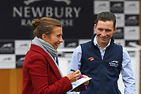 Jockey Jason Watson shares a joke in the Parade Ring during Racing at Newbury Racecourse on 12th April 2019