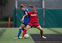Seattle, Washington - Saturday May 14, 2016:  Seattle Reign FC defender Carson Pickett (16) and Portland Thorns FC defender Katherine Reynolds (2) during the first half of a match at Memorial Stadium on Saturday May 14, 2016 in Seattle, Washington. The match ended in a 1-1 draw.