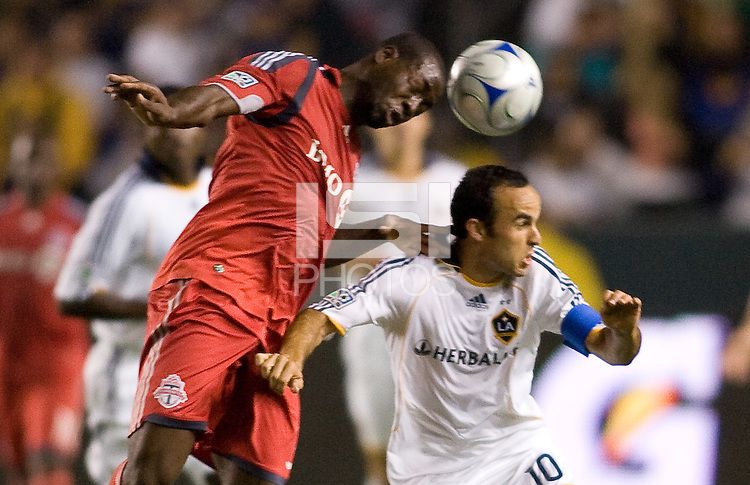 Toronto FC defender Nana Atttakora goes over the top of LA Galaxy's Landon Donovan. The LA Galaxy defeated Toronto FC 2-0 at Home Depot Center stadium in Carson, California on Saturday September 19, 2009...