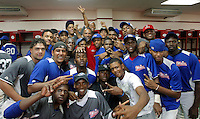 Former MLB outfielder Moises Alou (C, red) of the U.S. poses next to Dominican Republic prospects after their final game was held up by the rain at the Quiskeya National Stadium in Santo Domingo. The Tournament which aims to maximize the ability of Major League Baseball organizations to scout in the Dominican Republic. According to the MLB's office in the Dominican Republic, this year, the tournament introduced 23 new baseball prospects. July 29 2011. ViewPress/ Kena Betancur