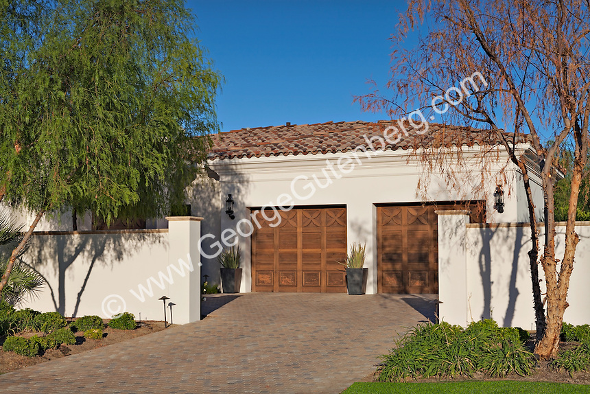 Ornate wooden garage doors
