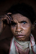 Hundari Pusika poses for a portrait outside her hut in Salpojola village in Niyamgiri hills. She is one of the many people who will get displaced if the aluminium company Vedanta carries on with its plans of mining of Bauxide in Niyamgiri hills in Rayagara district of Orissa in India.