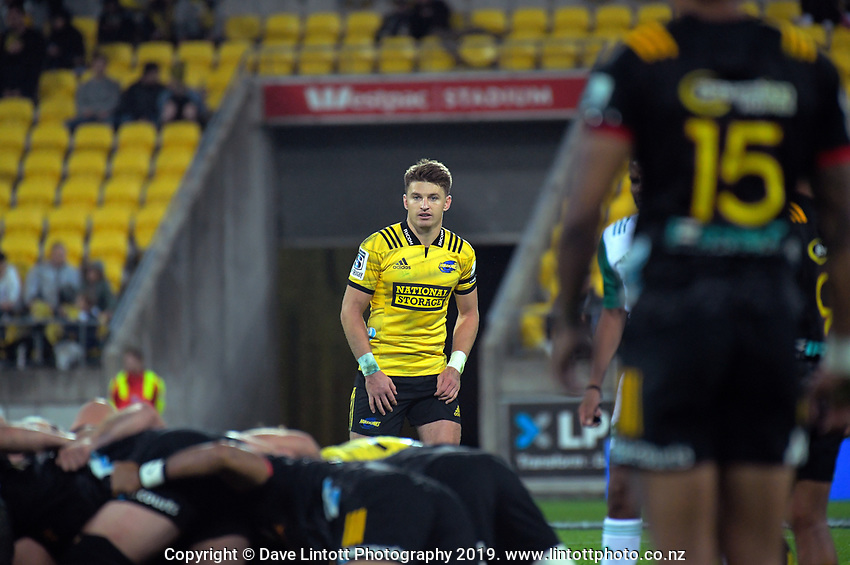 Beauden Barrett watches a scrum during the Super Rugby match between the Hurricanes and Chiefs at Westpac Stadium in Wellington, New Zealand on Friday, 27 April 2019. Photo: Dave Lintott / lintottphoto.co.nz