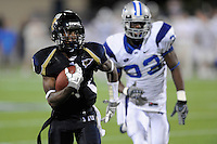 11 October 2008:  FIU wide receiver T.Y. Hilton (4) takes a Paul McCall pass 63 yards for a touchdown in the fourth quarter as Middle Tennessee State safety Kevin Brown (33) follows in pursuit in the FIU 31-21 victory over Middle Tennessee at FIU Stadium in Miami, Florida.