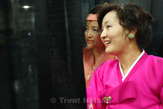 Trent Nelson  |  The Salt Lake Tribune.Jeonghee Park, left, and Eum Hee Lee modeled traditional Korean outfits in the fashion show at the Asian Festival in Sandy, Utah, Saturday, June 11, 2011.