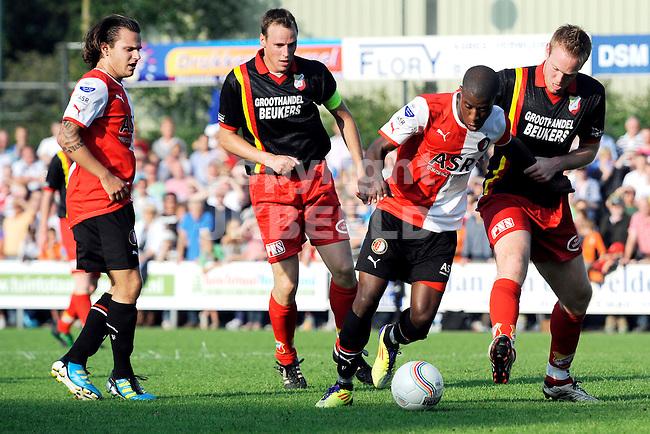 ERICA - SC Erica - Feyenoord voorbereiding seizoen 2011-2012 05-07-2011  Guyon Fernandez tussen twee tegenstanders links Ricky van Haaren.