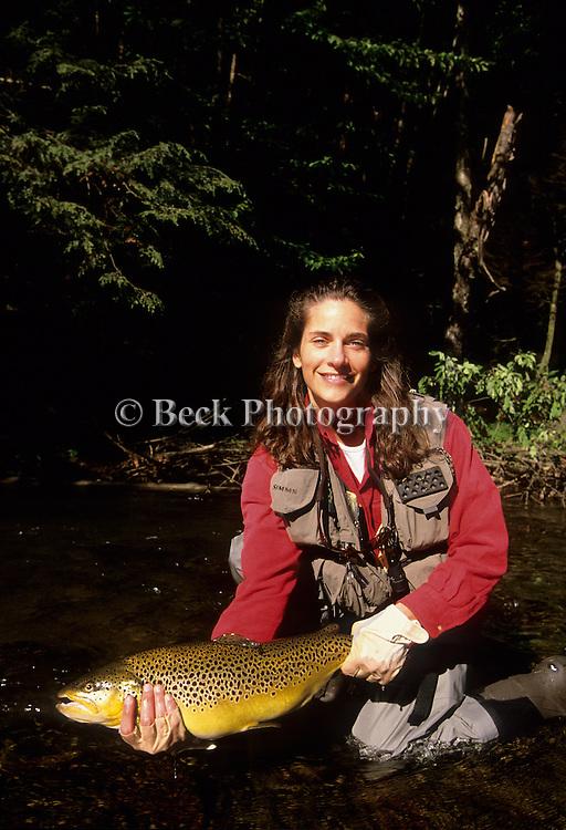 Nicole DiGiovanni and a brown trout.