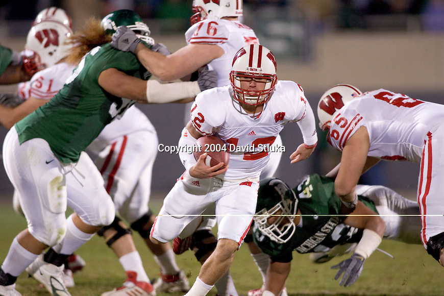EAST LANSING, MI - NOVEMBER 13: Quarterback Tyler Donovan #12 of the Wisconsin Badgers carries the ball against the Michigan State Spartans at Spartan Stadium on November 13, 2004 in East Lansing, Michigan. The Spartans beat the Badgers 49-14. (Photo by David Stluka) *** Local Caption *** Tyler Donovan