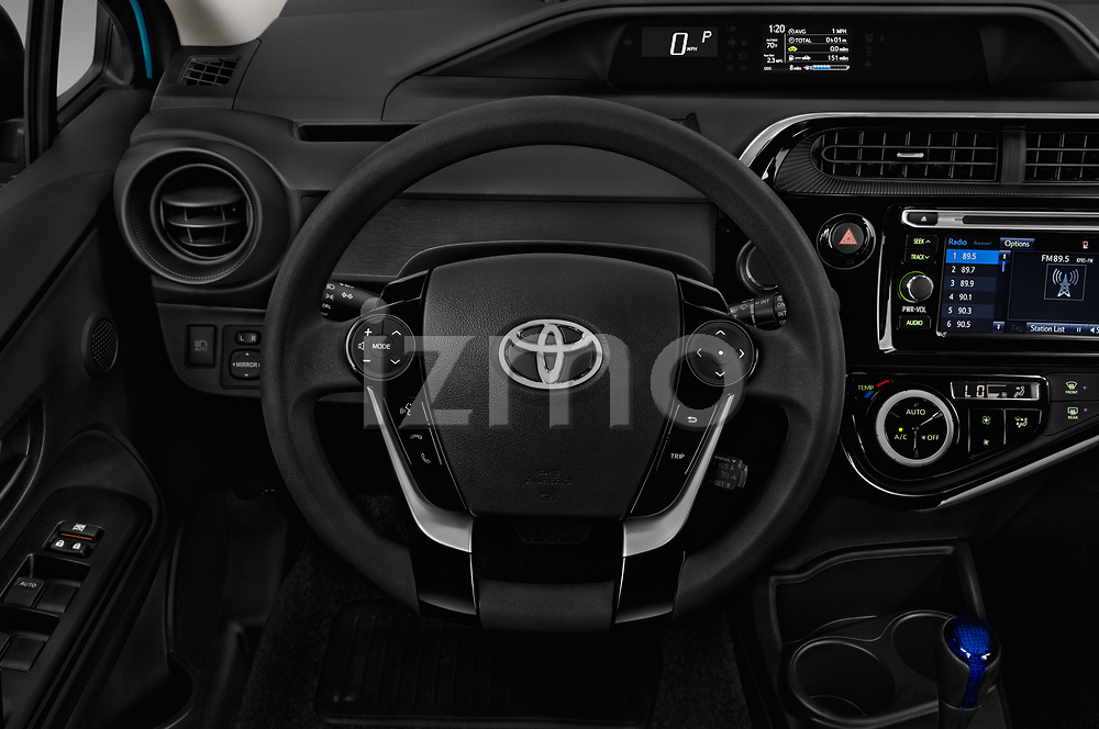 Car pictures of steering wheel view of a 2018 Toyota Prius c One 5 Door Hatchback